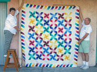 Jenney and Bill display donation quilt
